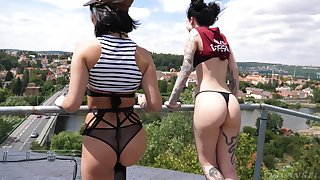 Rash and reckless bitch Charlotte Sartre poses on cam on the roof